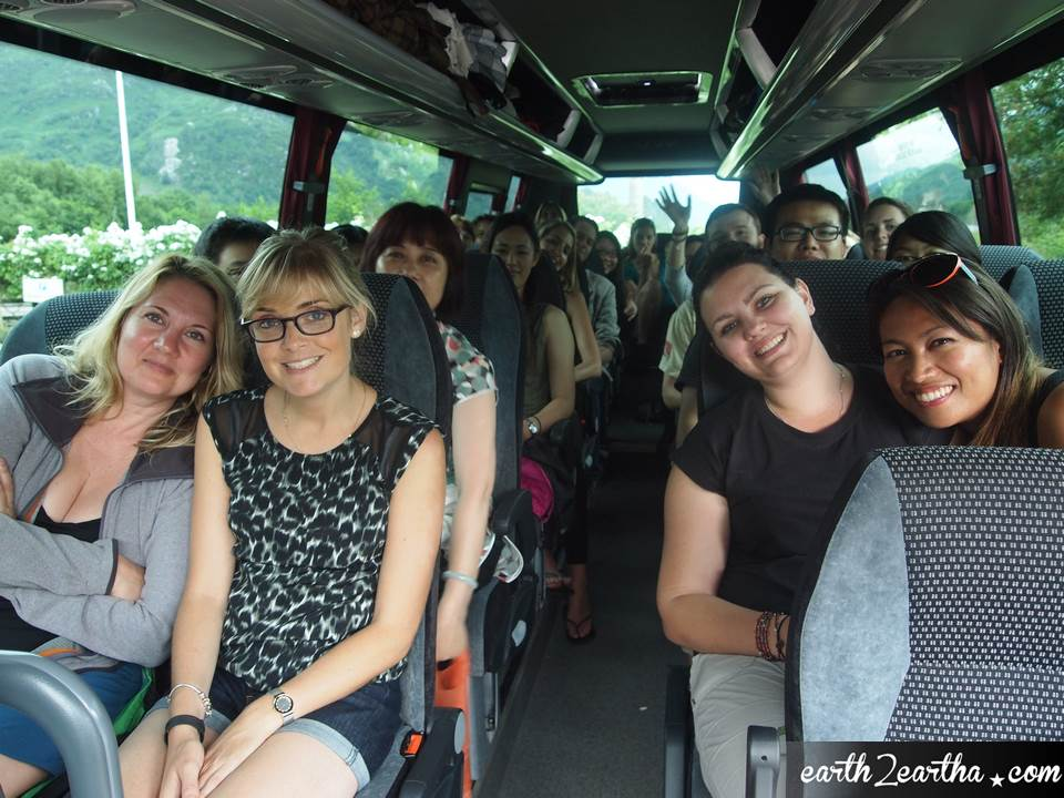 The tour group in MacBackpackers' Bus